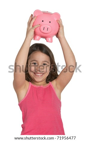 Smiling happy little girl with piggy bank