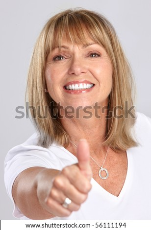 stock photo smiling happy mature woman thumb over grey background 56111194 stock photo : Closeup portrait of a sweet mature female over white ...