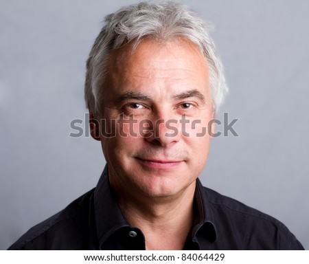 Smiling, happy older man, isolated headshot