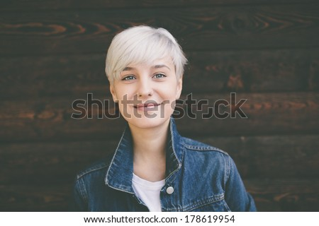 smiling happy real blond young woman #178619954