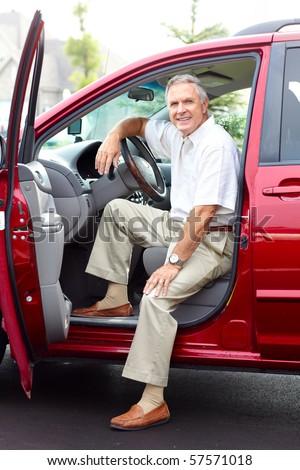 Smiling happy senior man  in the car