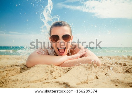 smiling happy summer splash on coast