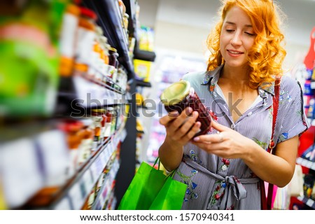 Smiling happy woman doing shopping in supermarket Stock photo ©