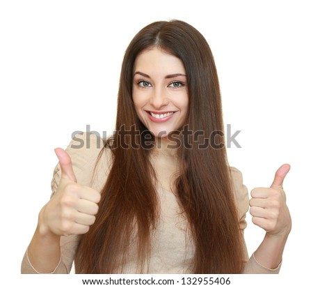 Smiling happy woman with two thumbs up and looking isolated on white background