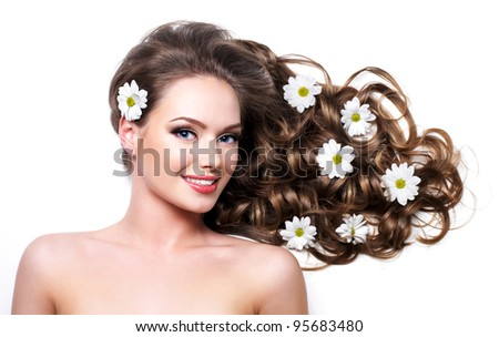 Smiling healthy woman with beautiful long hair  - white background