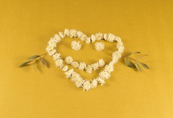 smiling heart from flowers on a yellow background