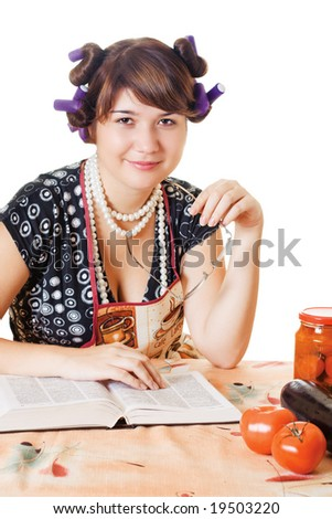 Smiling housewife sitting by the table with glasses