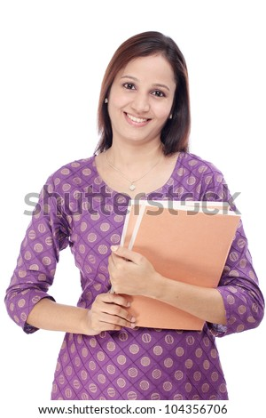 Smiling Indian female student against white