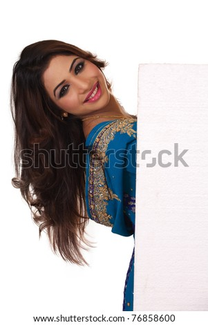 Smiling Indian girl with ad space. Isolated on white background ...