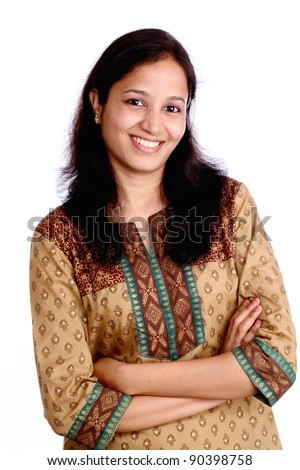 Smiling Indian woman with crossed arms