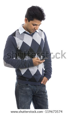 smiling Indian young man with mobile on white background.