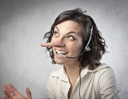Smiling insincere receptionist with long nose talking on the telephone
