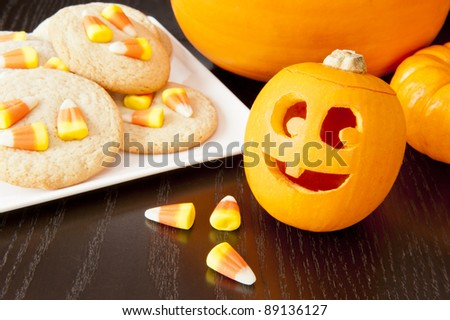 Smiling jack-o-lantern with candy corn cookies