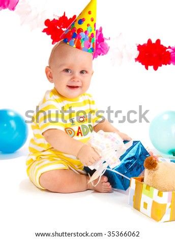 Smiling kid sitting with his birthday presents