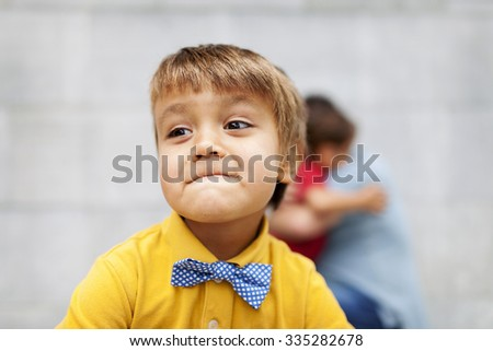 smiling kid with a bow tie #335282678