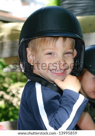 Smiling kid with a helmet on his head