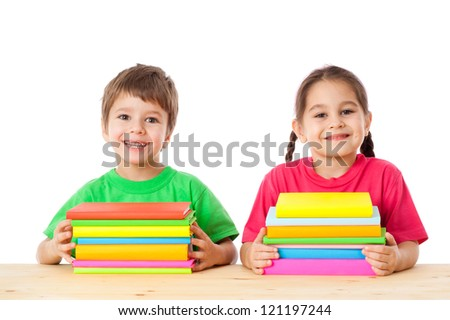 Smiling kids with pile of books, isolated on white