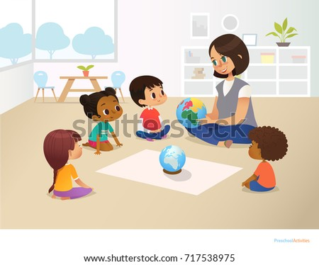 Smiling kindergarten teacher shows globe to children sitting in circle during geography lesson. Preschool activities and early childhood education concept.  illustration for poster, flyer