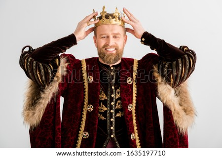smiling king wearing crown on head isolated on grey Stockfoto ©