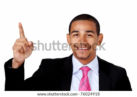 Smiling latino businessman pointing to copy space