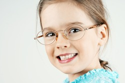 Smiling little blond girl with glasses