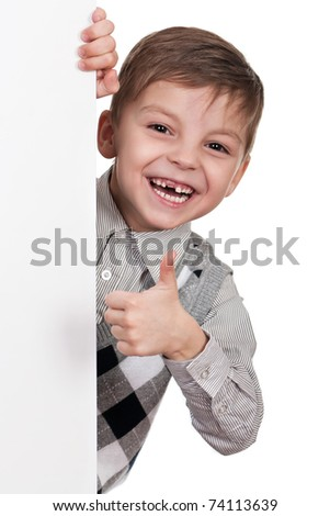Smiling little boy holding empty white board