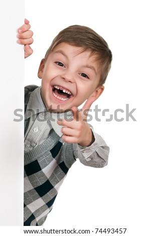 Smiling little boy holding empty white board