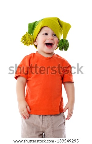 Smiling little boy in funny hat, isolated on white
