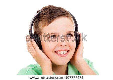 Smiling Little Boy Listening To Music On Headphones Against White