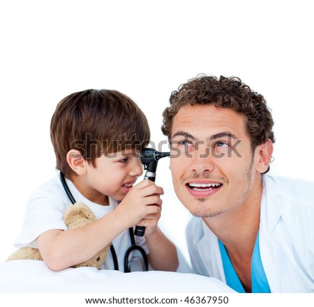 Smiling little boy playing with the doctor against a white background