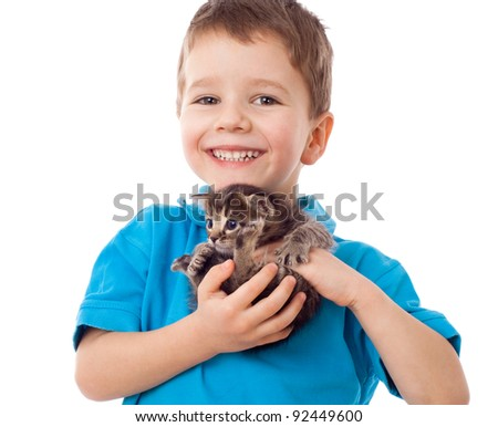 Smiling little boy with kitty in hands, isolated on white