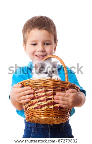 Smiling little boy with kitty in wicker, isolated on white