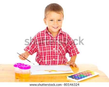 Smiling little boy with watercolor paintings, isolated on white