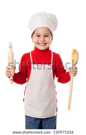 Smiling little cook with ladle and rolling pin, isolated on white