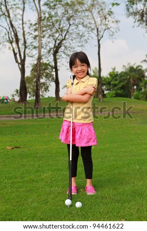 Smiling little girl at golf club