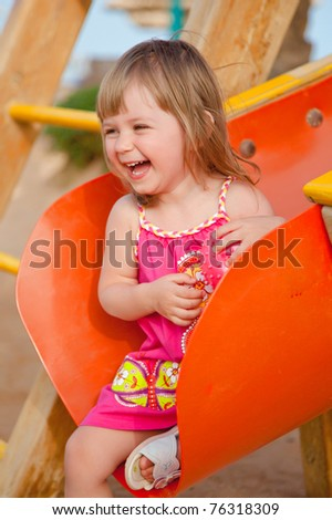 Smiling little girl at playground