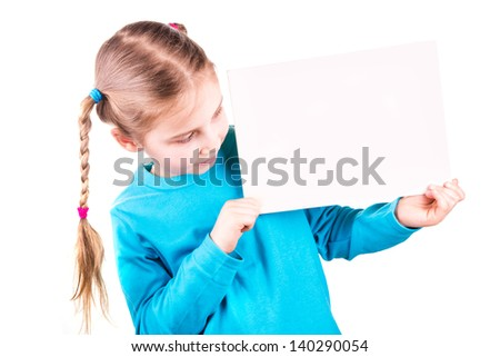 Smiling little girl holding an empty white card for you sample text isolated on white