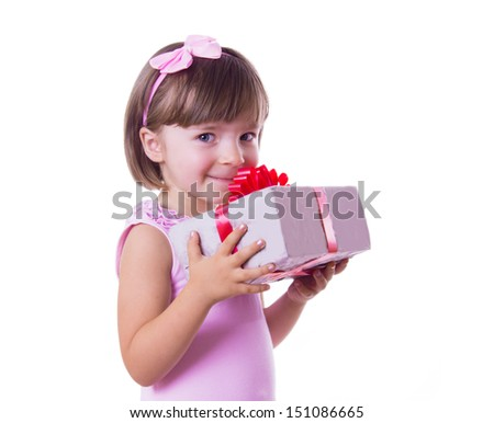 Smiling little girl holding present box over white