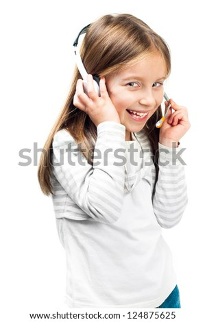 Smiling little girl in headset isolated on a white background