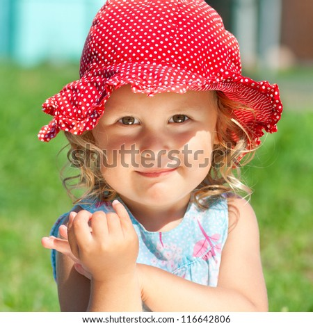 Smiling little girl in sunhat outdoors