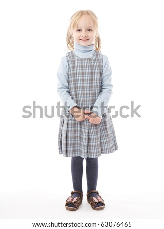 Smiling little girl is standing over white background