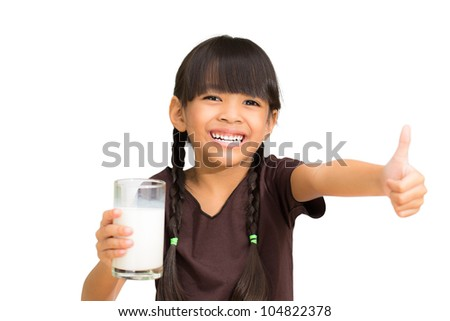 Smiling little girl with a glass of milk, Isolated on white