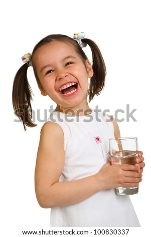 smiling little girl with a glass of water on a white background