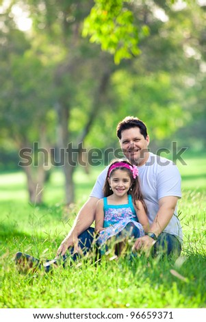 Smiling little girl with a heart in the park
