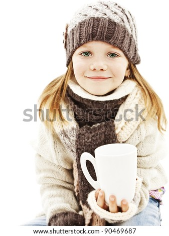 Smiling little girl with a white cup of hot drink. Isolated on white background