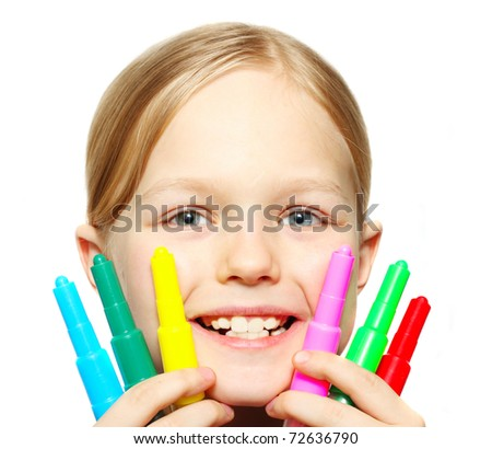 Smiling little girl with colorful felt pens in hands
