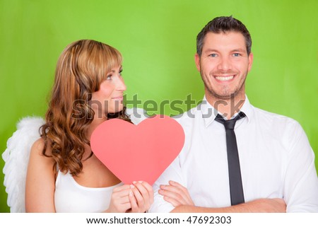 Smiling loving lovers giving a present