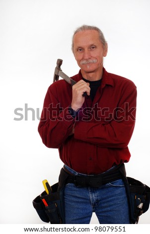 Smiling, male contractor holding a hammer, wearing tool belt