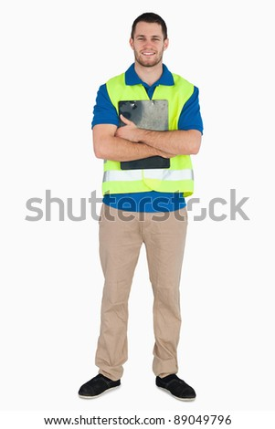 Smiling male in safety jacket holding his notes against a white background