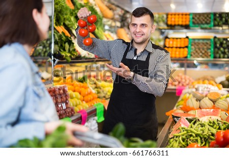royalty free friendly seller weighing eco bananas on 523323760